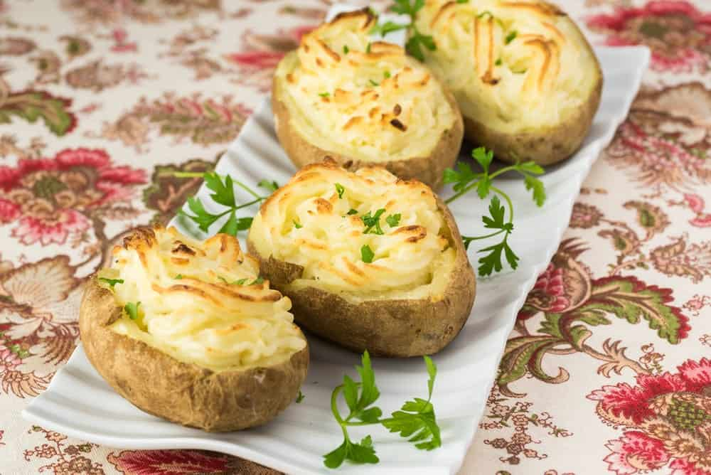 A plate of fresh twice-baked potatoes.