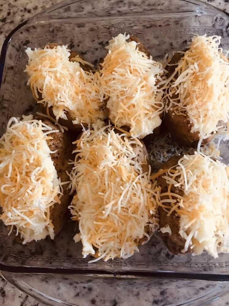 The potatoes are topped with cheese.