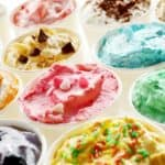 A close look at various different ice cream on display.