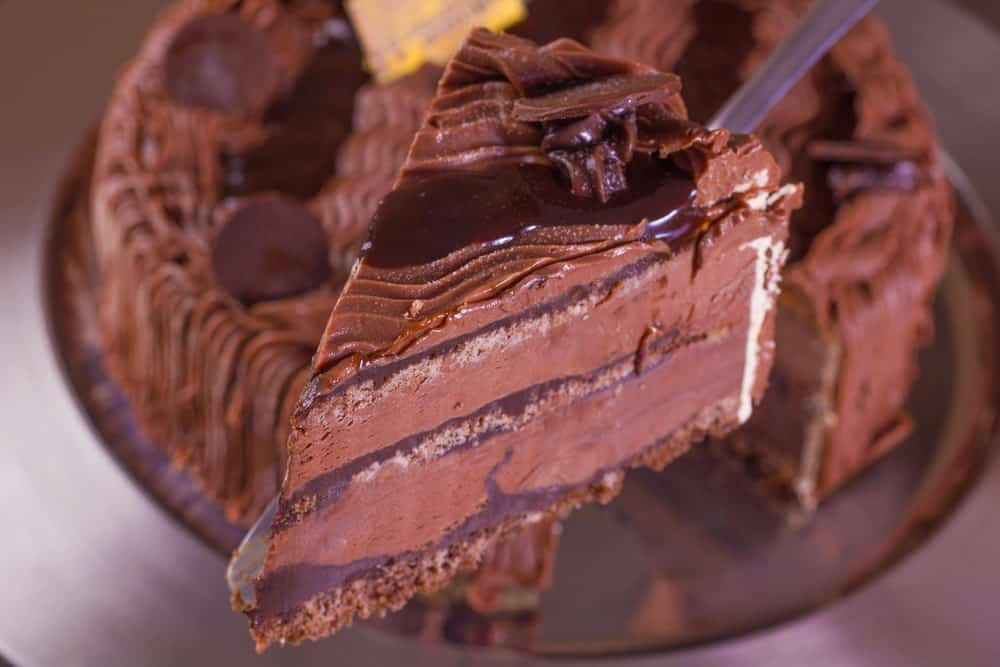 A close look at a slice of chocolate ice cream cake.