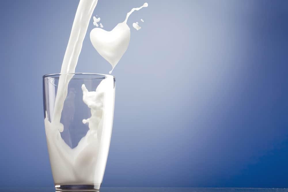 Skim milk being poured into a glass.