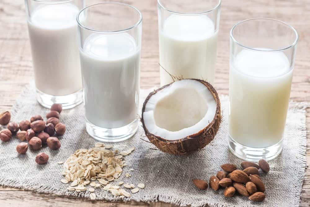 Glasses of different lactose-free milk alternatives.