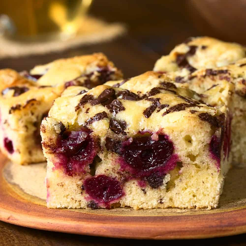 Pieces of cherry chunky blond brownies.
