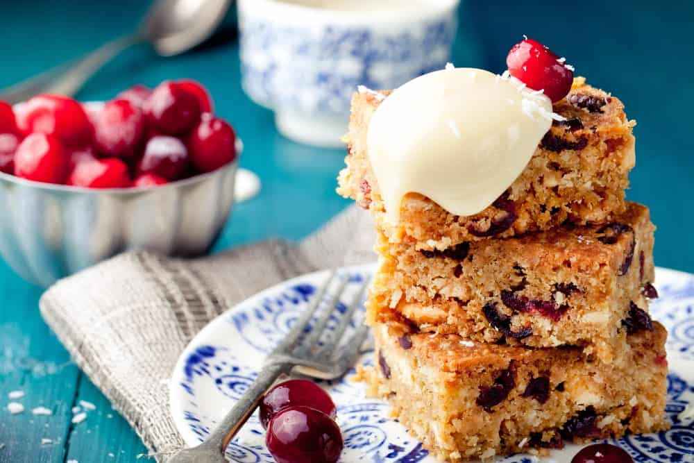 A stack of white chocolate cranberry blondies.