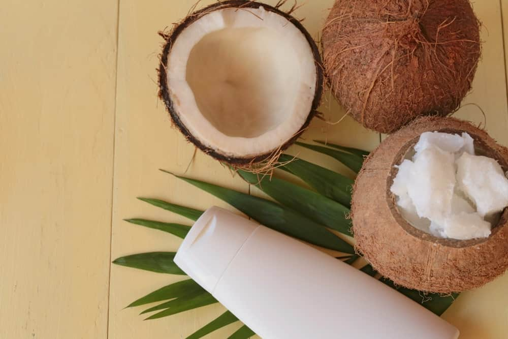 A look at unrefined coconut oil with fresh coconuts.