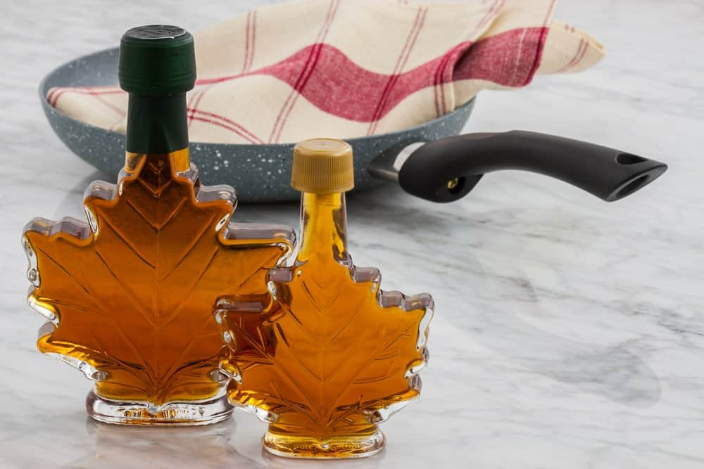 A couple of bottles of dark maple syrup.