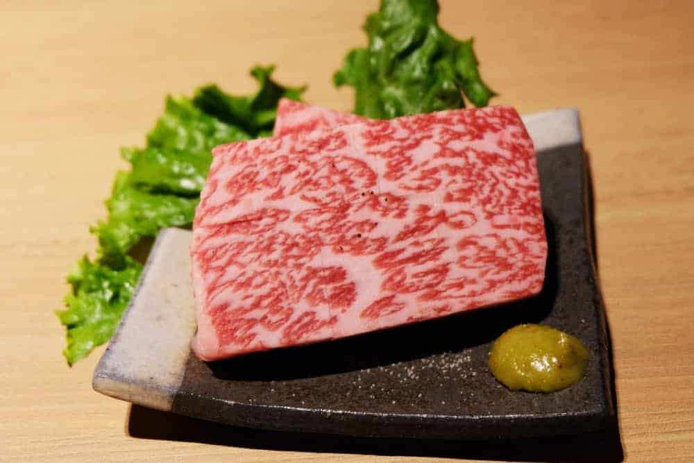 A5 grade wagyu beef on ceramic plate.