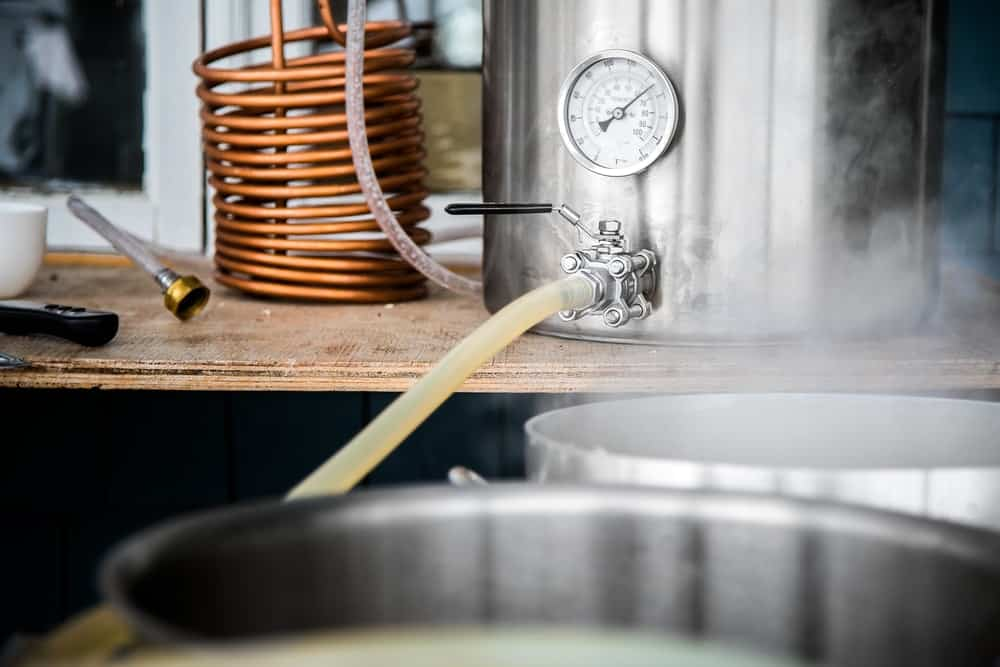 This is a look at home brewing equipment in action of making beer.